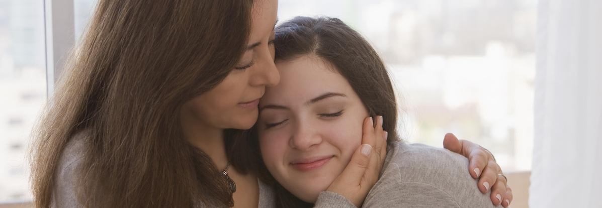 Chilean mother hugging daughter